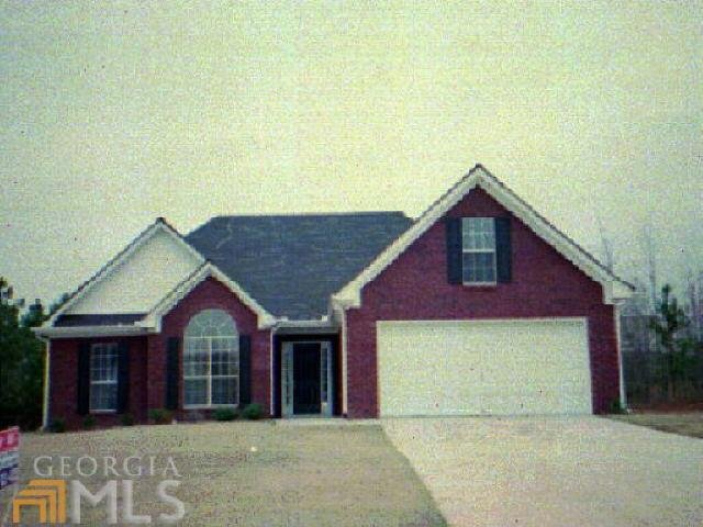 Photo of home for sale at 65 Greenfield Way, Covington GA