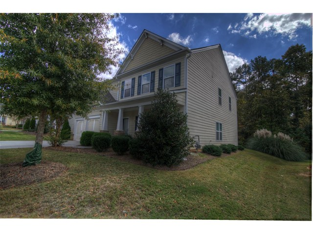 Photo of home for sale at 2305 Village Green Dr, Fairburn GA