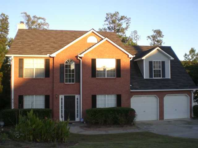 Photo of home for sale at 5020 Burling Mill Dr, Lithonia GA