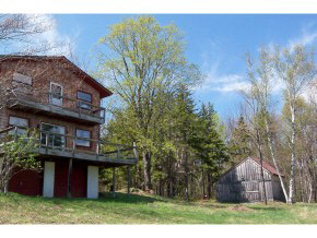 This modest chalet style home with separate barn...