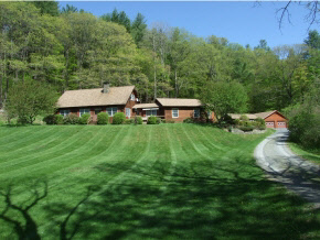 High quality, well built and well maintained log home on 27 acres with scenic brook running through the property.Great Room with gas fireplace & radiant heat. Soapstone wood stove w/stone chimney. Property features perennial gardens, open meadow, stone walls, small pond with gazebo. There is a detached heated building with greenhouse,hot tub & studio/exercise room, & Large 2 car garage. Nice new kitchen with granite. 3 decks.High efficiency heating (system 2000) & insulation. Four season recreation area & great trail access.  Internet available at 500 mbps!!!!   EZ to show.