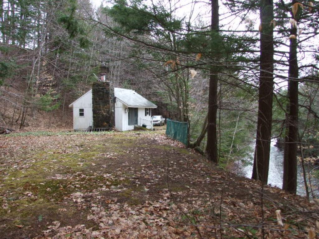 Two parcels of land with a 2 bedroom 1 bath camp located on the Mill Brook in a nice area.Camp has not been occupied for many years.There is power, a survey, well, septic, long driveway in.State permit EC-2-0174.Parcel with camp is 1.4 acres. Parcel with road frontage is 1.32 acres.