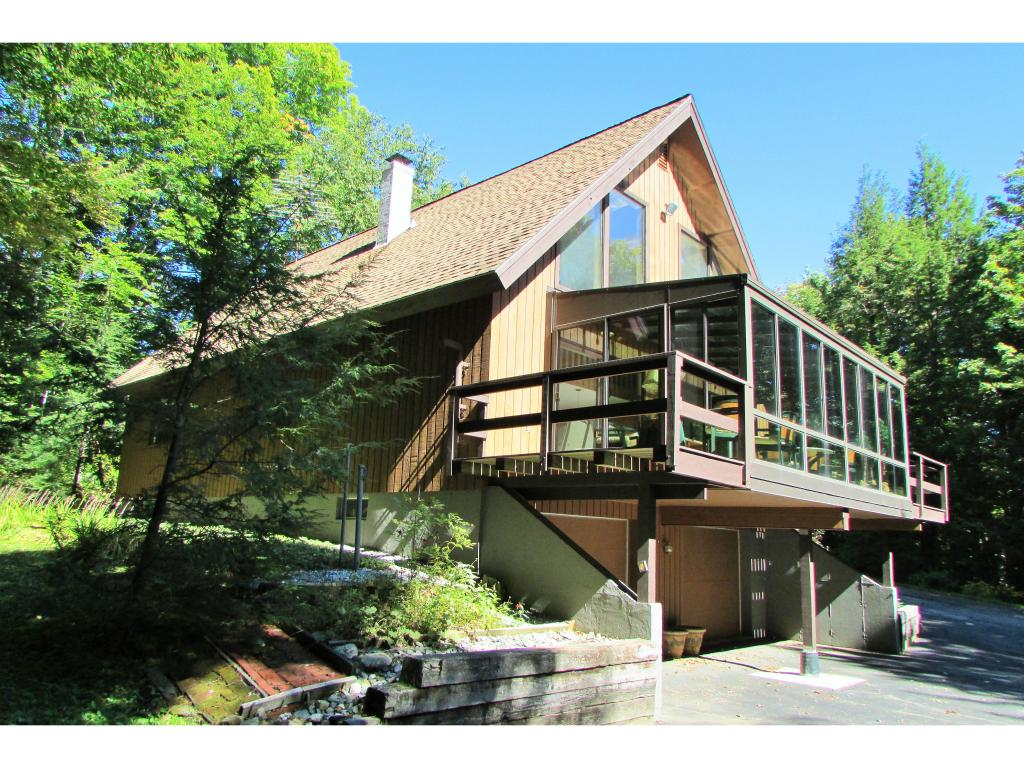 This home is just minutes from Mount Snow, local...