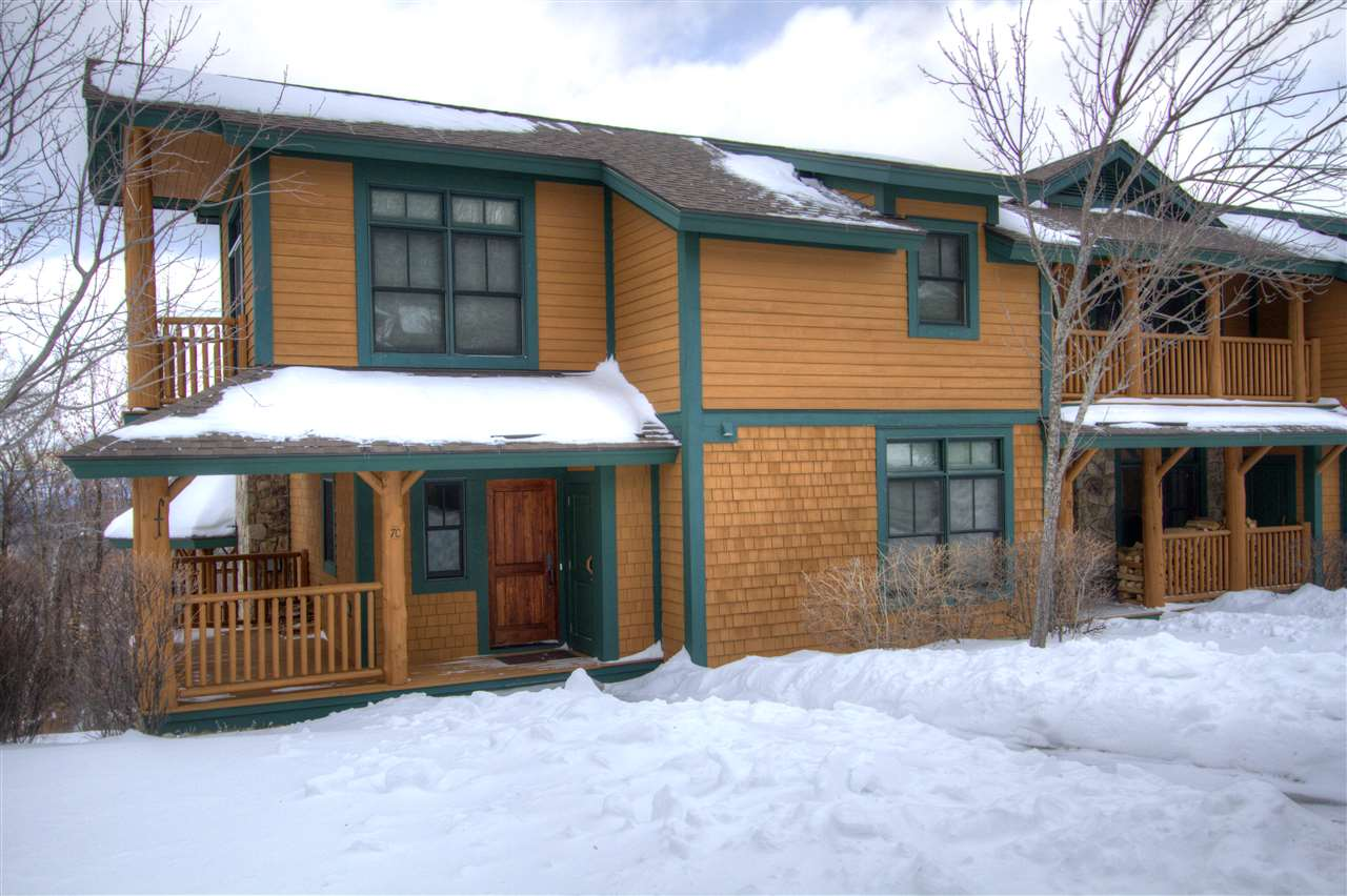 Luxury, mountainside TreeTop Townhome boasts big...