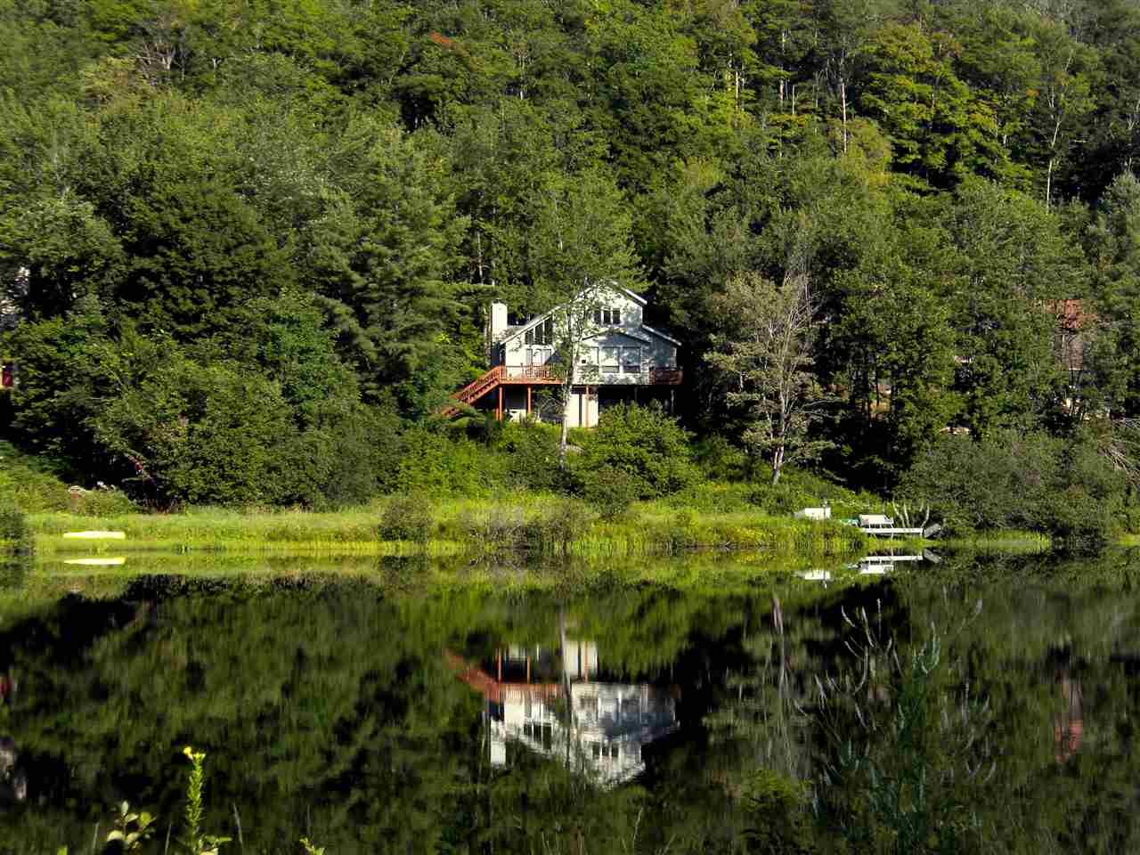 Lakefront Offering. This magnificent country home...