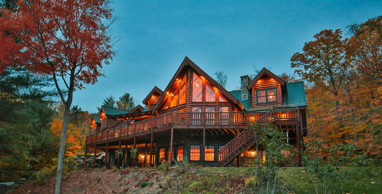 """The Custom built """"Black Bear Lodge"""" is the ultimate mountain log home you have been dreaming of! With picturesque views, this magnificent log and timber home features a dramatic living room with cathedral ceiling and wood burning stone fireplace, an excellent kitchen with beautiful granite counter tops, and a spacious first floor master bedroom also with a stone fireplace. Step out onto the expansive deck that overlooks panoramic mountain views and features stairs to the lower level patio. A home theater, large family room, wine closet, and a luxurious guest apartment round off the many amenities offered by this fabulous property. Craftsmanship of the highest quality throughout. The floor plan offers grand space, views and an appreciation for the elements of nature!"""