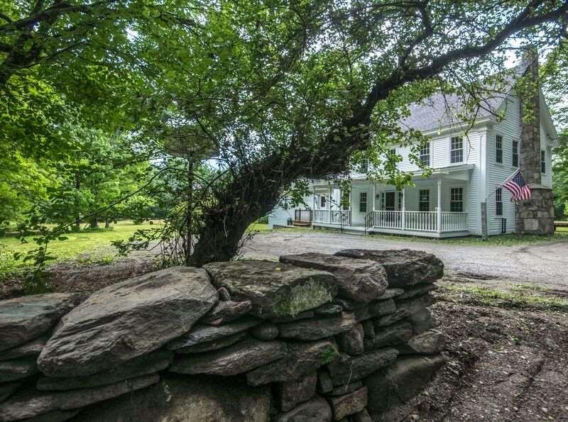 Gorgeous classic Vermont farmhouse with a blend...