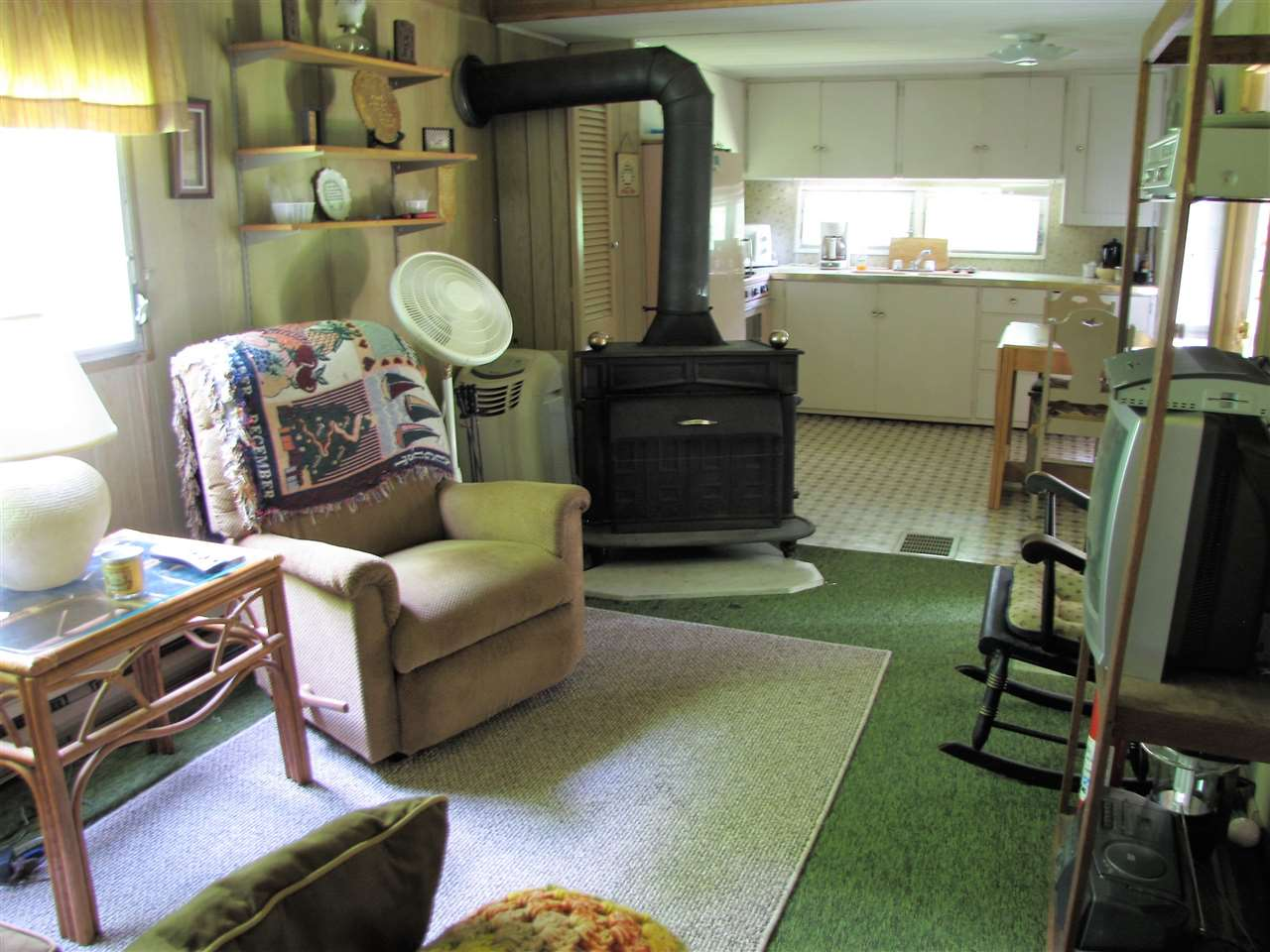 This mobile home sits on 1.2 lovely, level acres,...