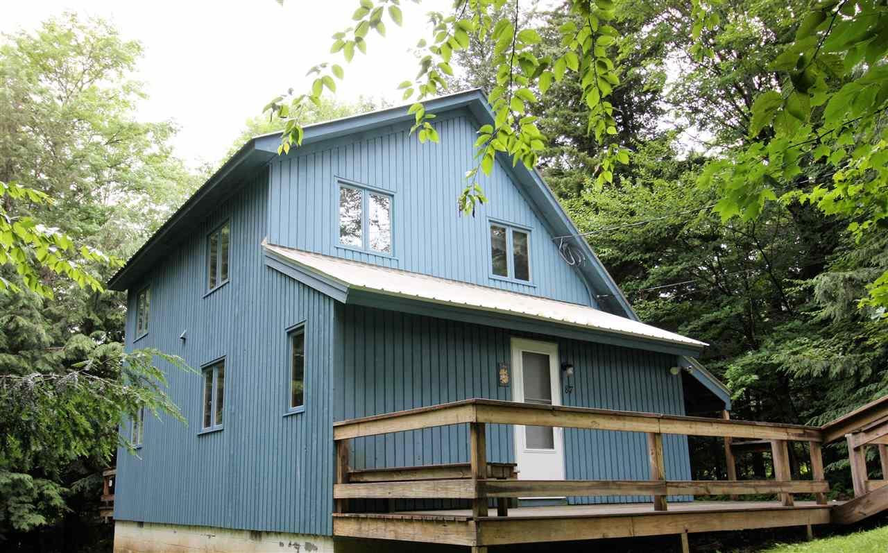 Four-bedroom, two-bath cedar saltbox/chalet...