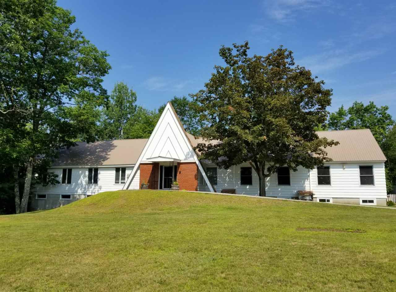 Large multiuse building that lends itself to many opportunities.  Bright and sunny rooms with storage capability and versatile enough for a school, office, gym or anything you can imagine (with town approval).  Spacious parking, nice level lot overlooking the Saco River.  Currently used as a Church and a School.