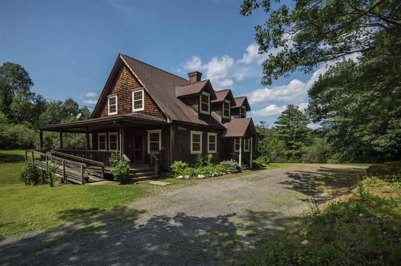 This handsome New England Cape style home with...