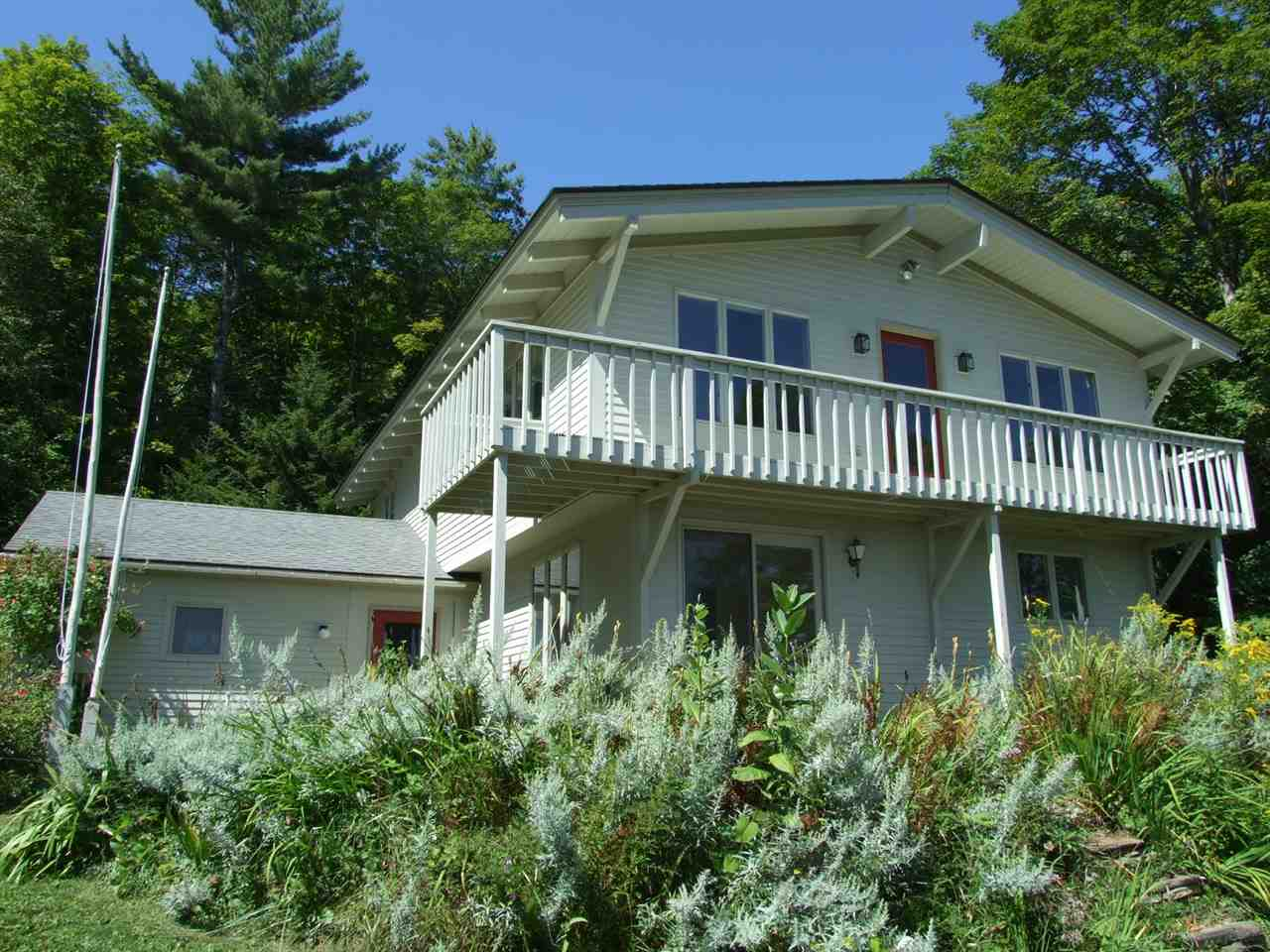 Open floorplan, 4 bedroom home on 18.93 acres in great Reading location with view of Mt Ascutney, nice open field & wooded acreage, lots of perennials. Separate small log studio with woodstove. Near trails.  Easy access to Okemo & Echo Lake!    (Road frontage is estimate)