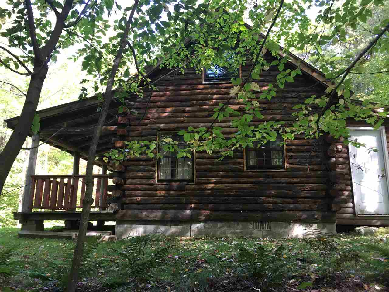 This authentic log cabin features a woodstove and...