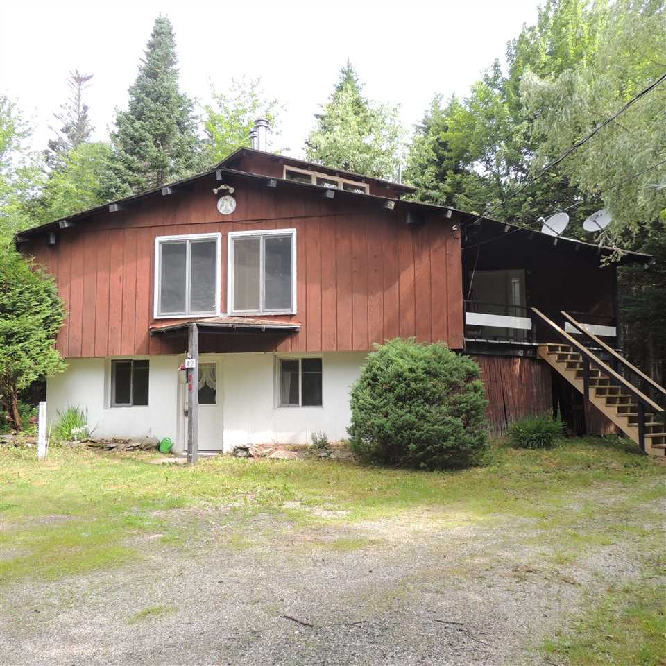 Updated chalet style home with 2 units: 3 bedroom...