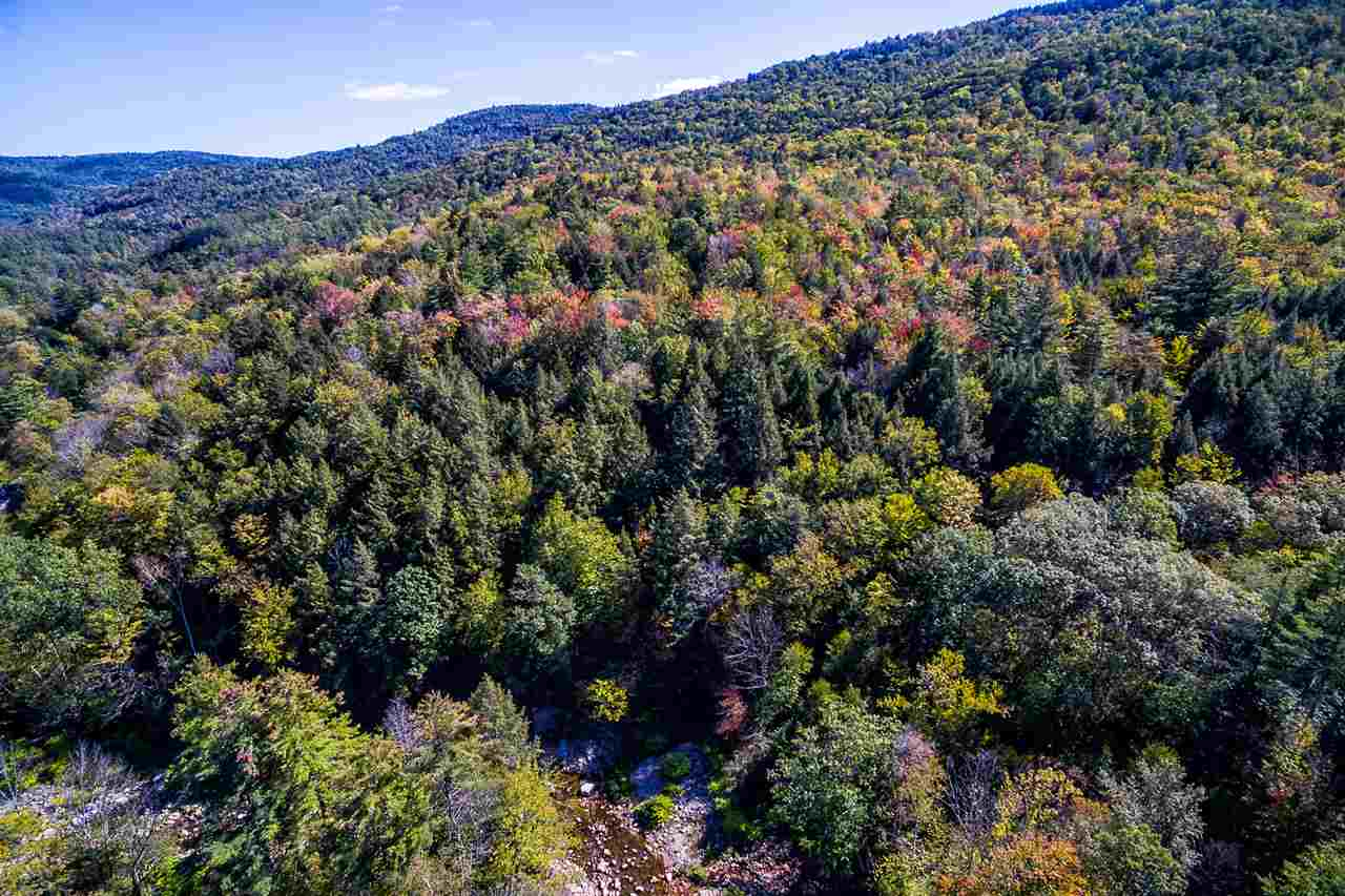 129 acres of mostly wooded and rolling land. A...