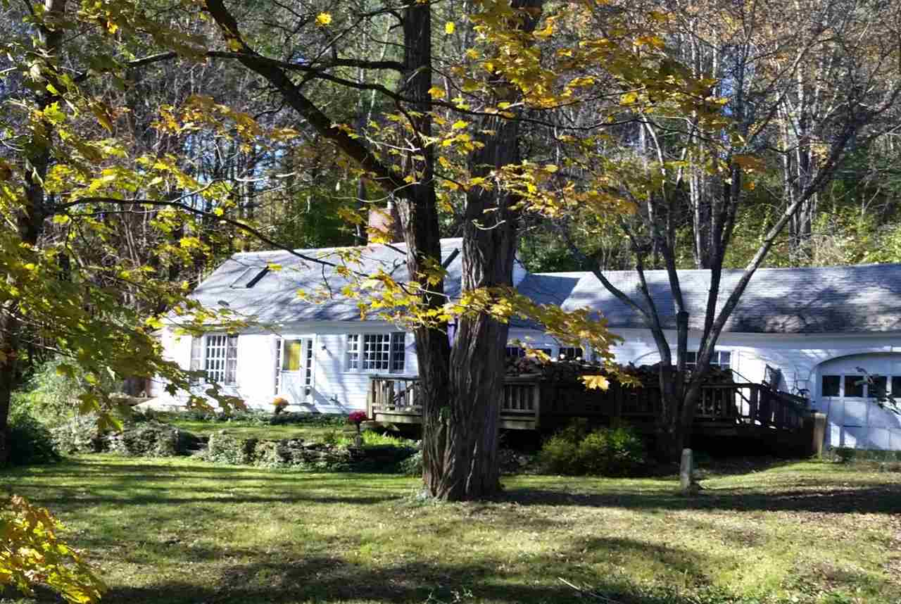 Nestled on a wooded bend, this charmed, 18th...