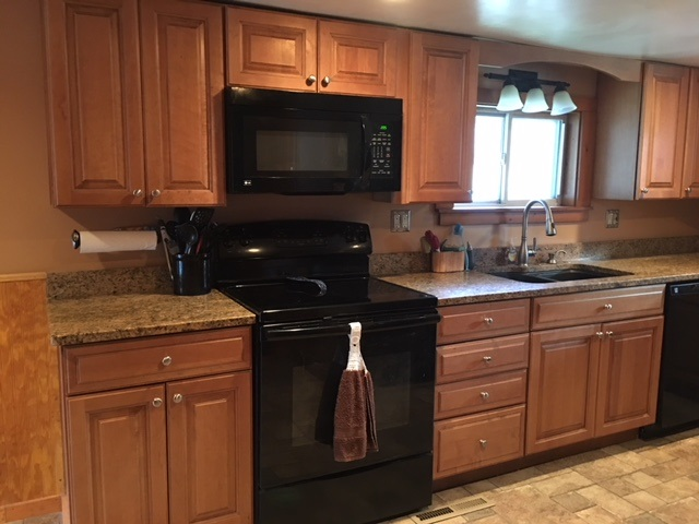 Newer Maple cabinets with granite counter top!