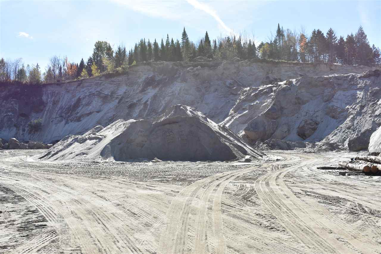 Existing gravel pit on 18 acres+/- with 46 x 36 truck garage w/ 25 x 20 addition.  Also includes screen plant. Great opportunity for for anyone looking to invest in a future business venture. Property can be purchased several different ways: Gravel pit w/ home on 20 ac+/- & equipment (list on file) for $725,000. Gravel Pit w/ home on 20 ac+/- NO equipment for $599,000. Home on 2 ac+/- for $225,000.