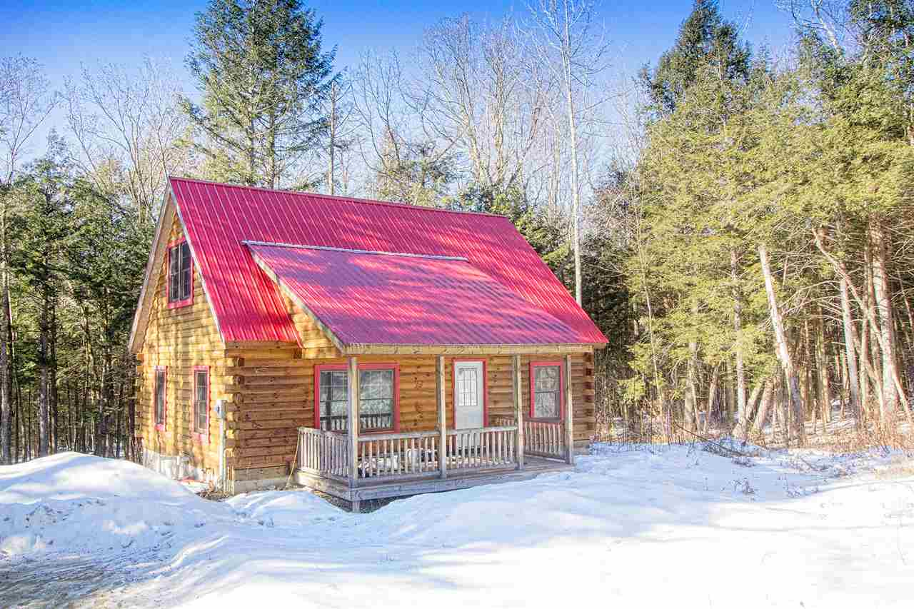 Authentic log cabin tucked away in the woods of...