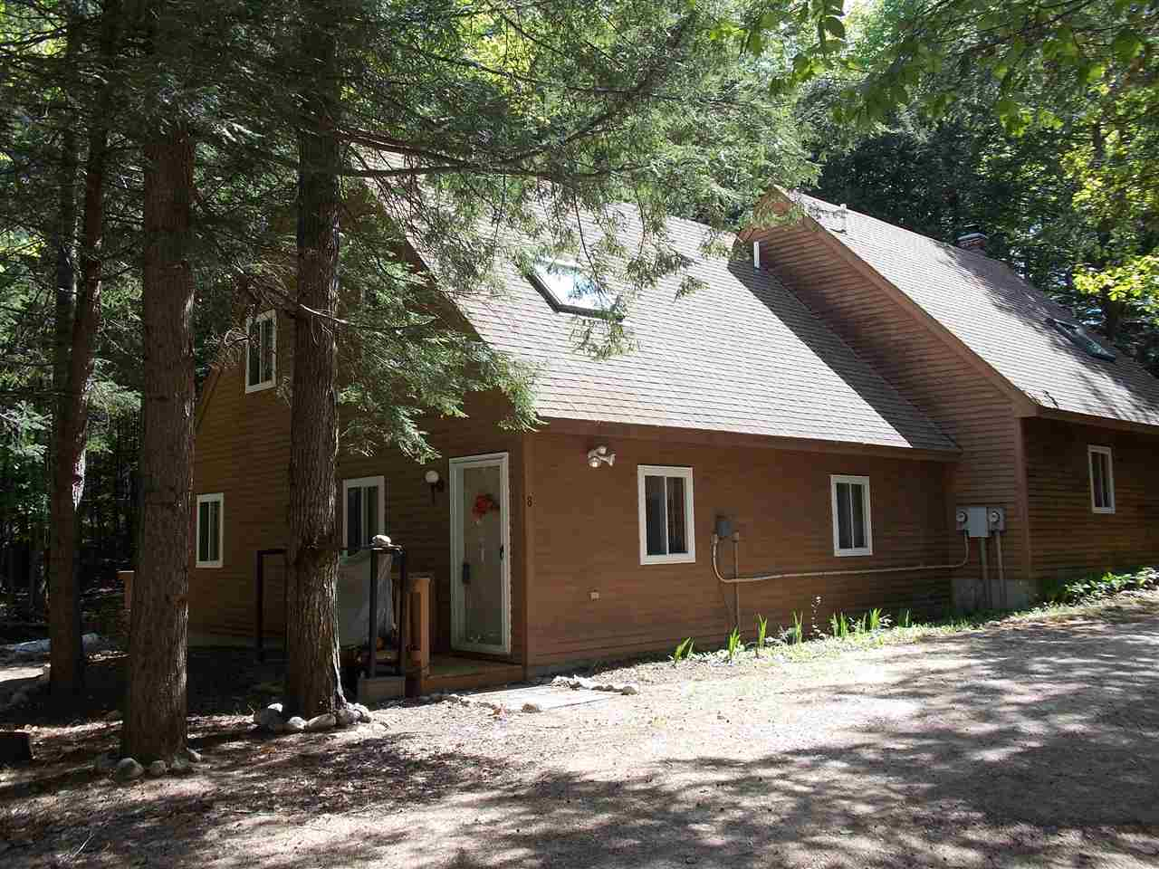 Minutes to Attitash, this townhouse is waiting for you to come relax by the woodstove. The mudroom entry with door to the open living space including living room, dining room and kitchen. First floor master bedroom with private full bath.  There are 2 ample sized bedrooms with skylights on the second floor and a 3/4 bath and laundry room. There is plenty of parking, a nice sized deck off the back overlooking a small brook. This great unit comes fully furnished for your convenience. Don't miss this great offering.