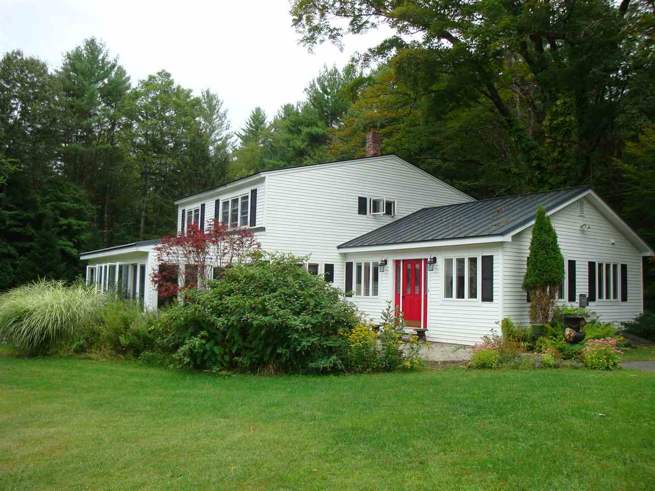 This delightful Vermont farmhouse is surrounded...