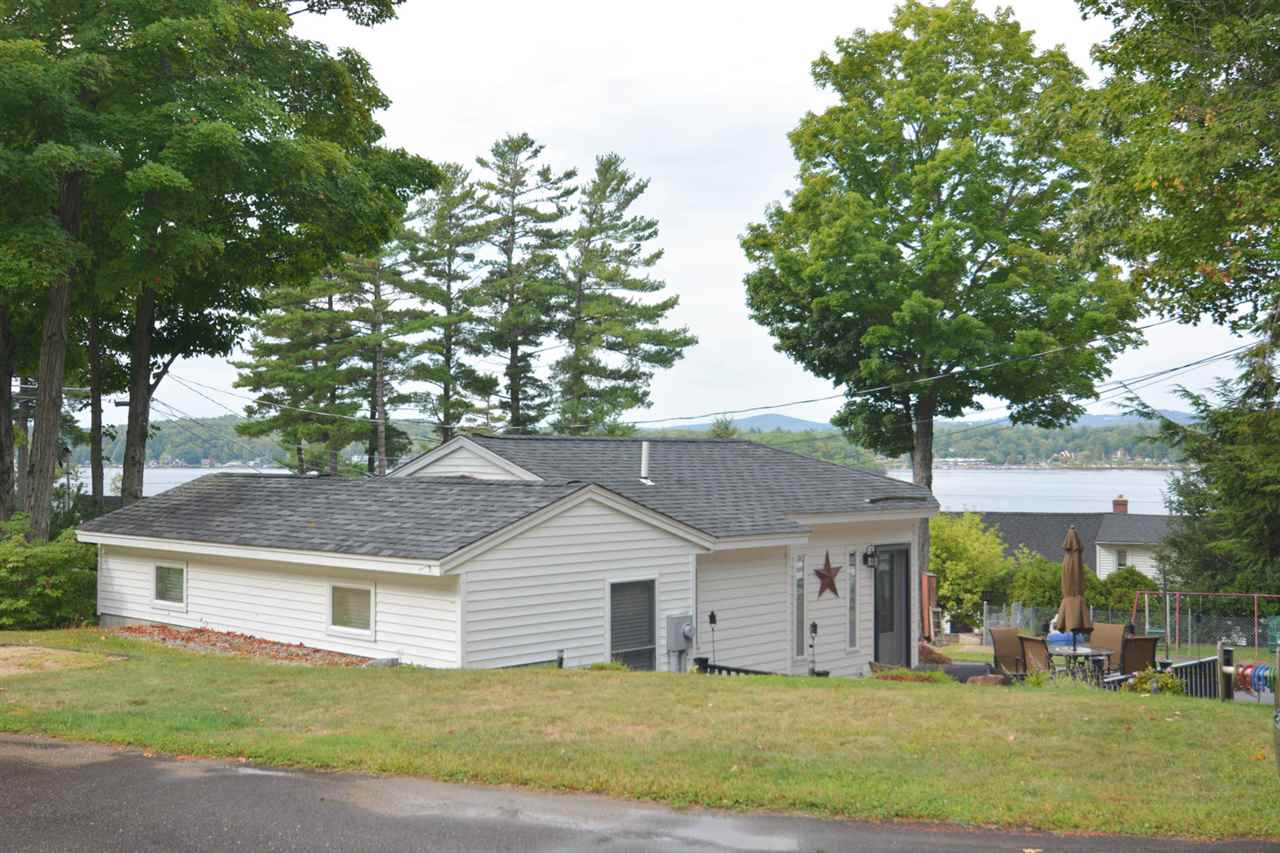 completely beautifully remodeled cottages bay bafb cottage overlooking property nh ha lake in winnipesaukee paugus laconia image on