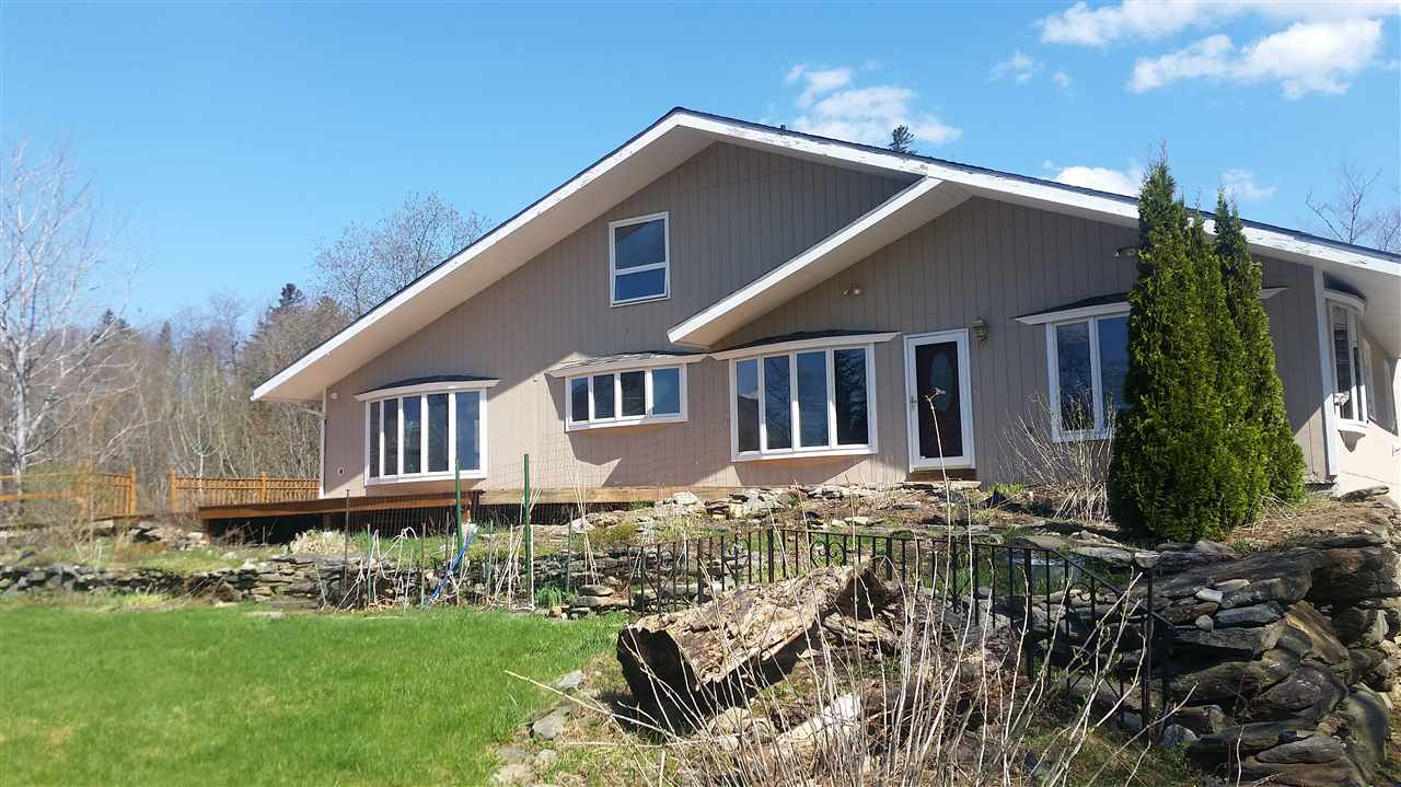 Set on a private 4+ acre lot with pond and views...