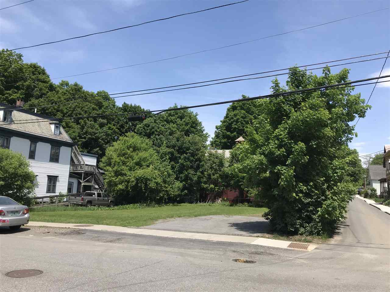 PERFECT CORNER VILLAGE BUILDING LOT IN BELLOWS...