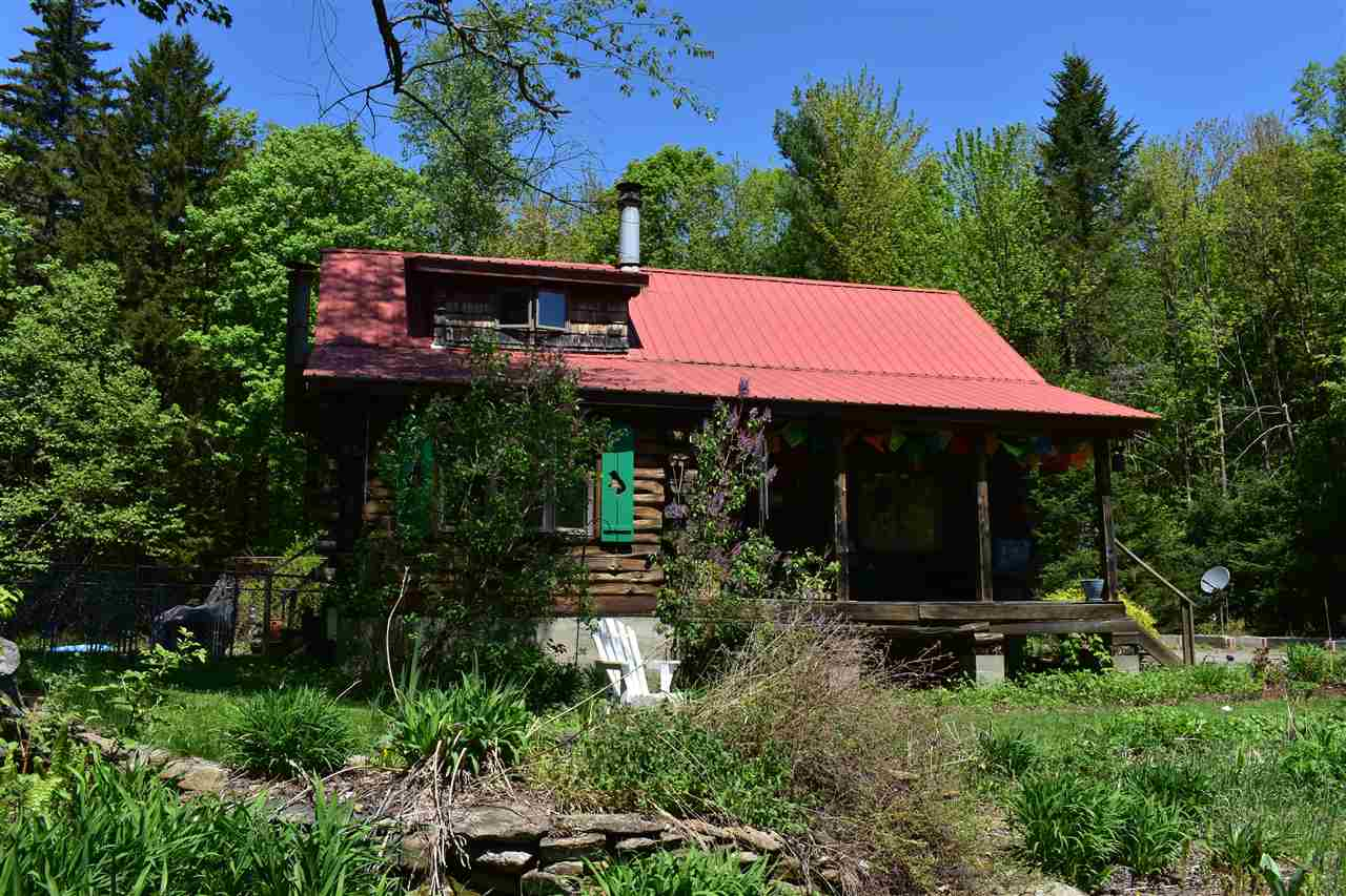 Private and charming log home tucked away in a...