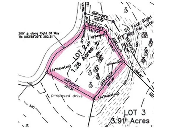 Here's an excellent permitted building lot...