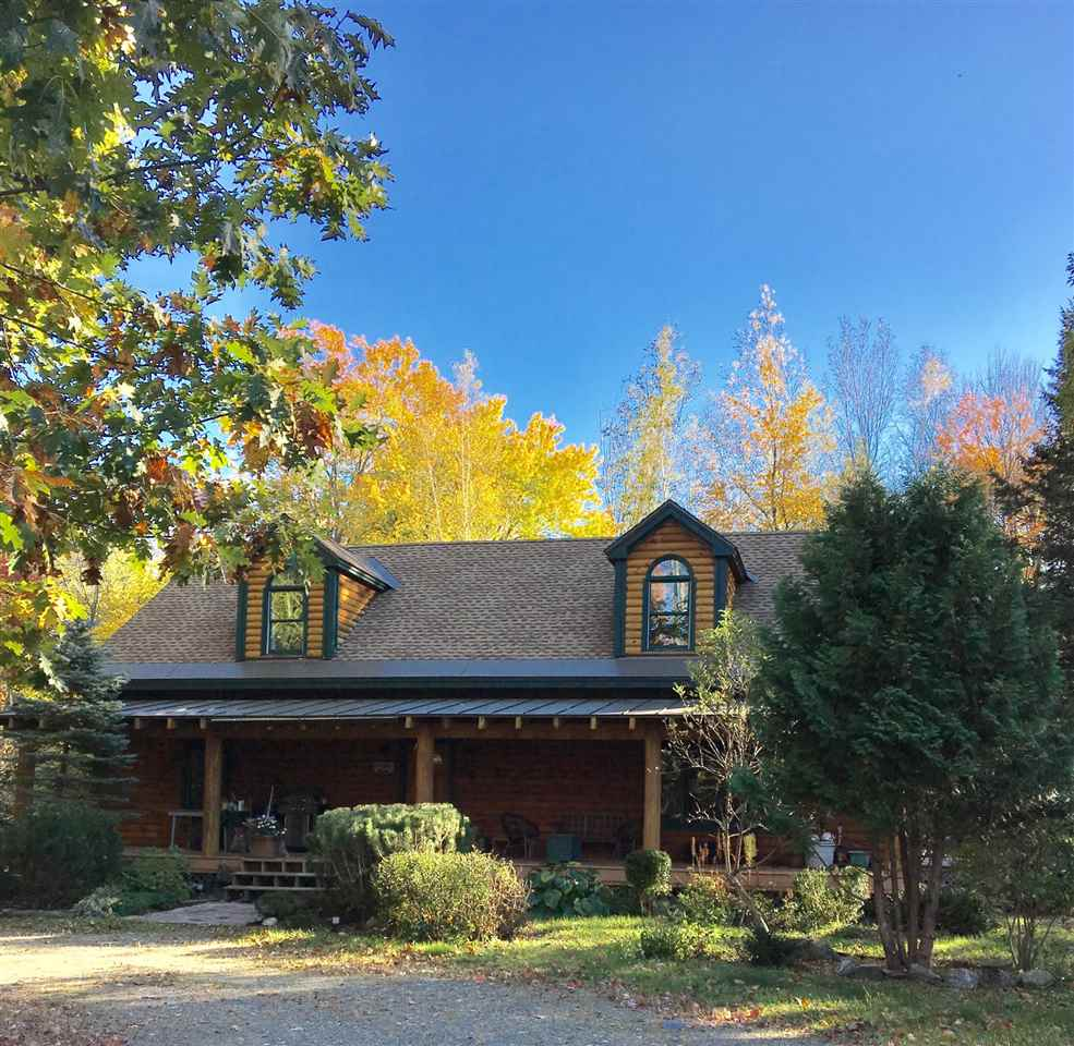 Beautiful log home on 14.2 acres of fields and...
