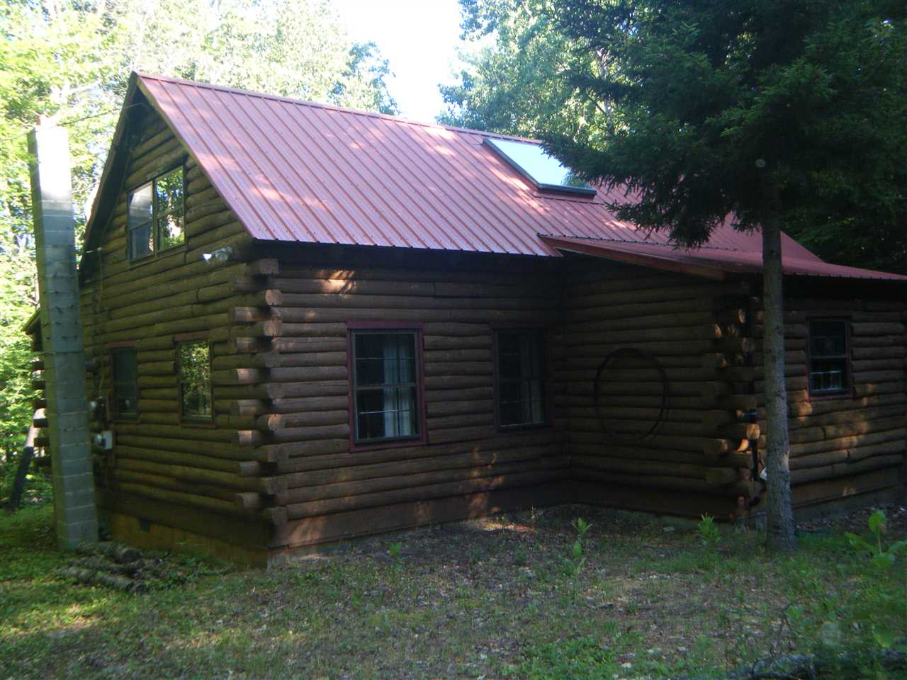 This rustic Log Cabin sits nestled among stately...