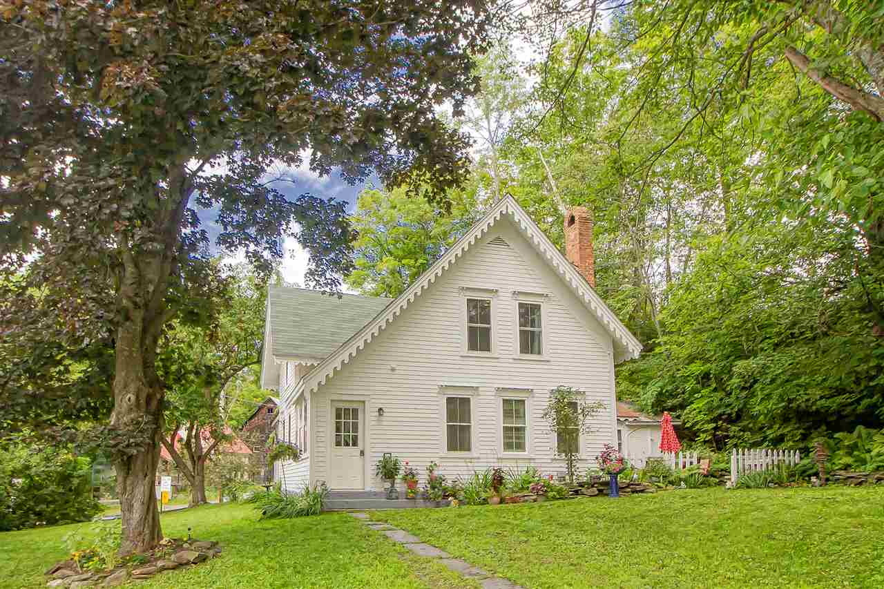 Enter this charming village home boasting an open...