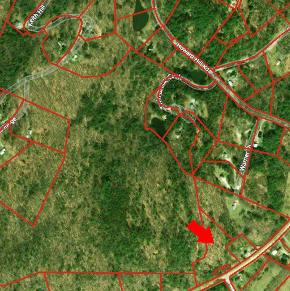 This beautiful 4.61 acre wooded lot is set back...