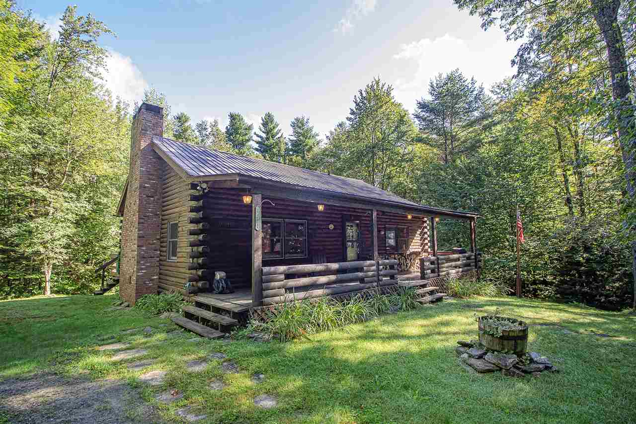 Live your Vermont dream in this charming log home...