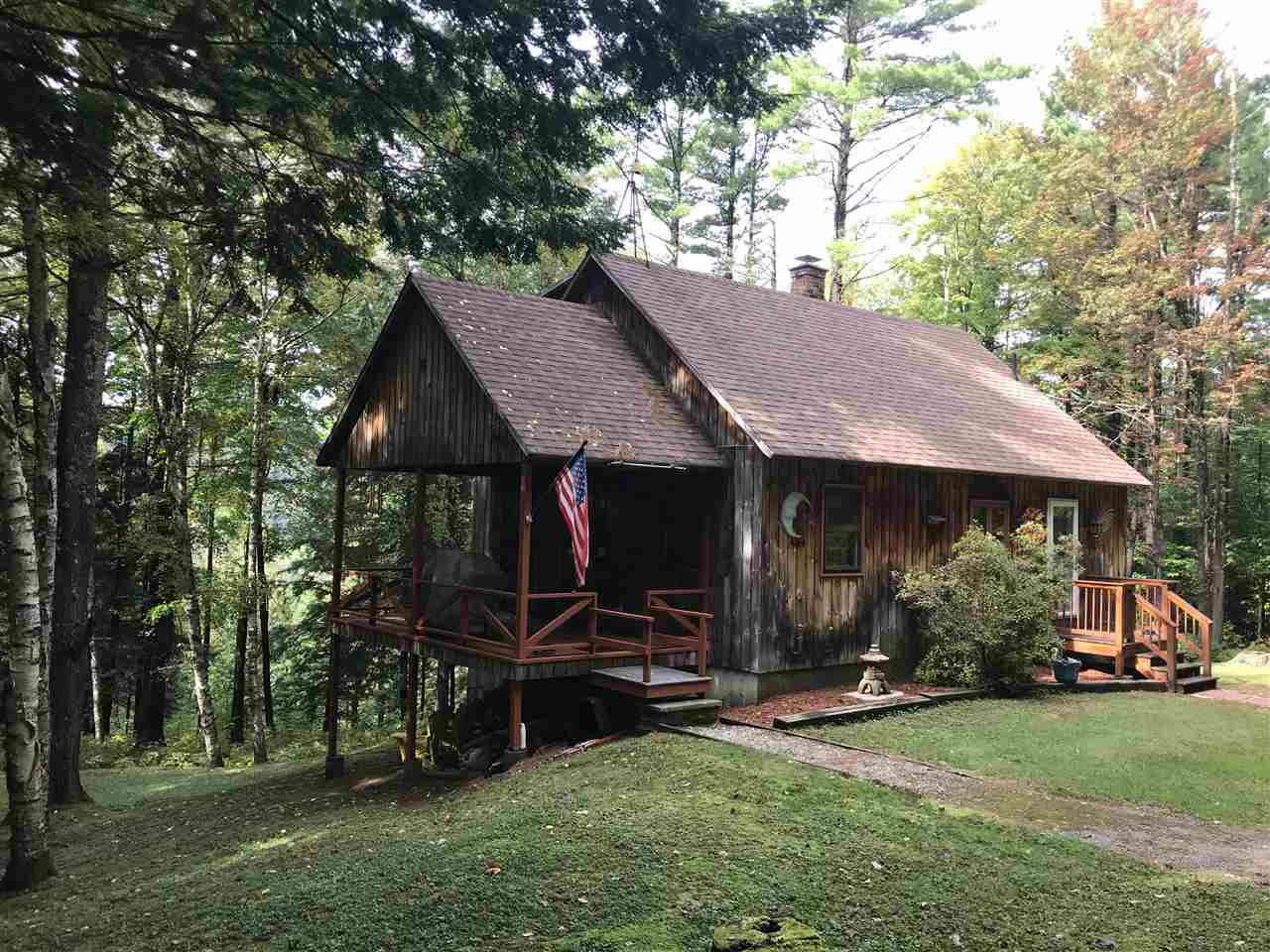 Close to town privacy!  This cozy cape sits on...