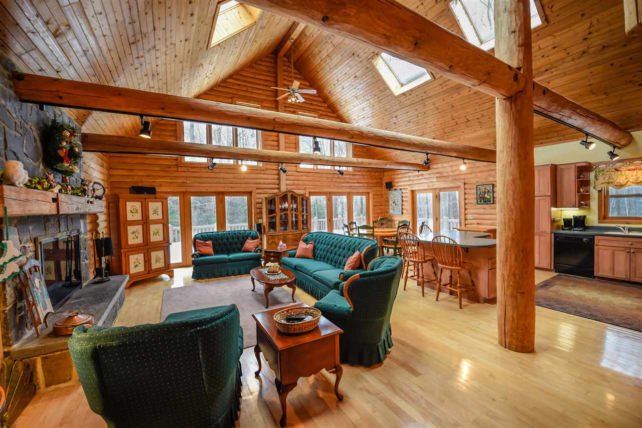 Breathtaking log home on 12 acres just up from...