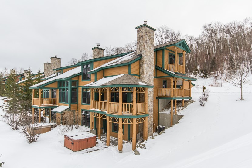 Enjoy true trailside living and skiing at...