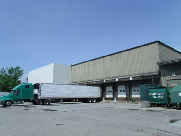 Warehouse Space with Racking Up to 20,000 SF Office Space Available  High bay industrial building with 35' clearance available for lease. Plenty of racking already in place. Flexible fit-up available. Offers a convenient, central location close to I-89 Exit 16 and Costco with 3 loading docks, municipal water and sewer and plenty of on-site parking.  Building permitted for additional 20,000 SF of new construction office or warehouse. Highly customizable!