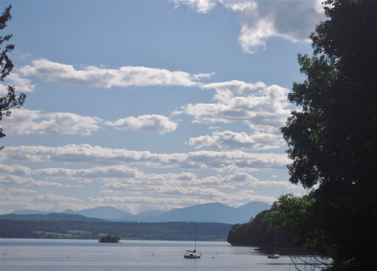 A private 20.1 acre parcel with open fields, woodlands and gorgeous views of Lake Champlain and the Adirondack High Peaks.  With Southerly and Westerly Exposure this property has infinite possibilities, whether it be a single family estate, a family compound or a further subdivision with 2 or 3 additional house sites.   There is a bonus .60 acre lakeshore lot with 100+ feet of frontage which could be used for seasonal docking, swimming, sailing and fishing or just enjoying the views and sunsets. Bring your architect and your dreams to this beautiful piece of Vermont.