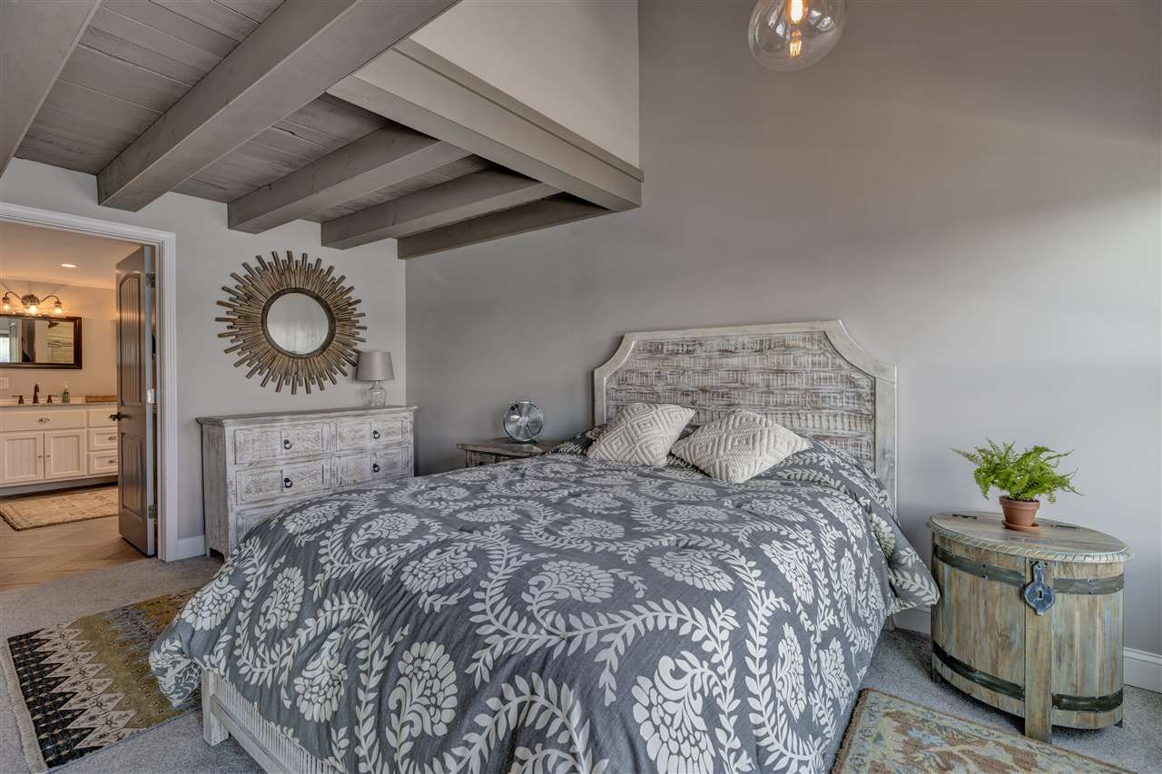 Second floor bedroom with dormer view to lake
