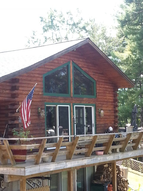 Great location for this log home on 1.0 acre lot, with beautiful mountain views and direct views of Mount Washington.  Nicely landscaped lot with many sitting areas to appreciate the views.  Enjoy this property as your primary or second home, or with Town approval could be the new location of your business. Built in 2004, recent improvements include the hurricane grade new roof.  Excellent home or business location.
