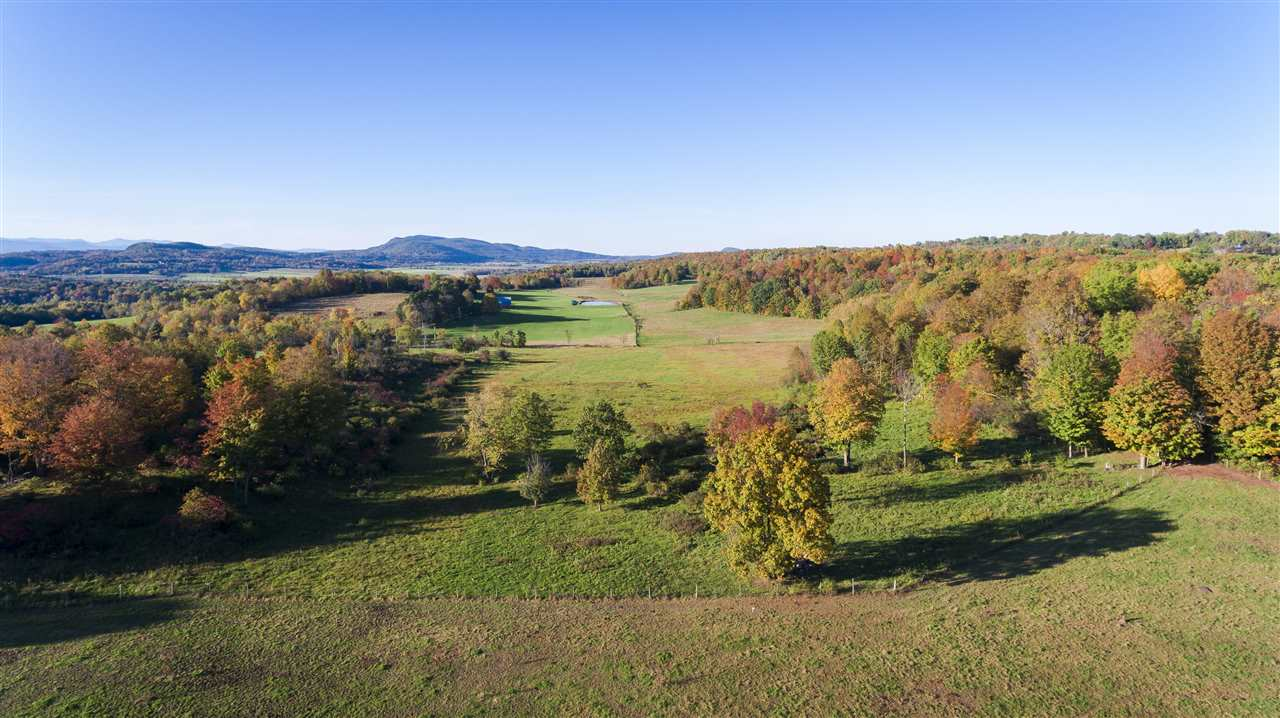 Premier house site in a very private Cornwall location.  Amazing views to the north across beautiful fields and on to Snake Mountain.  Watch the sunset light up the valley on a clear night!  Mostly open land with over a mile of fencing.  An elevated area up a grassy road is an outcrop of ledge and provides great Adirondack views.  The fields are currently grazed by Angus cattle and this property could easily serve a small gentleman's farm.  Will be deed restricted to one homestead (guest house and accessory buildings will be permitted).  Excellent septic capacity.  Very nice town maintained road. This land is not enrolled in the Current Use program.