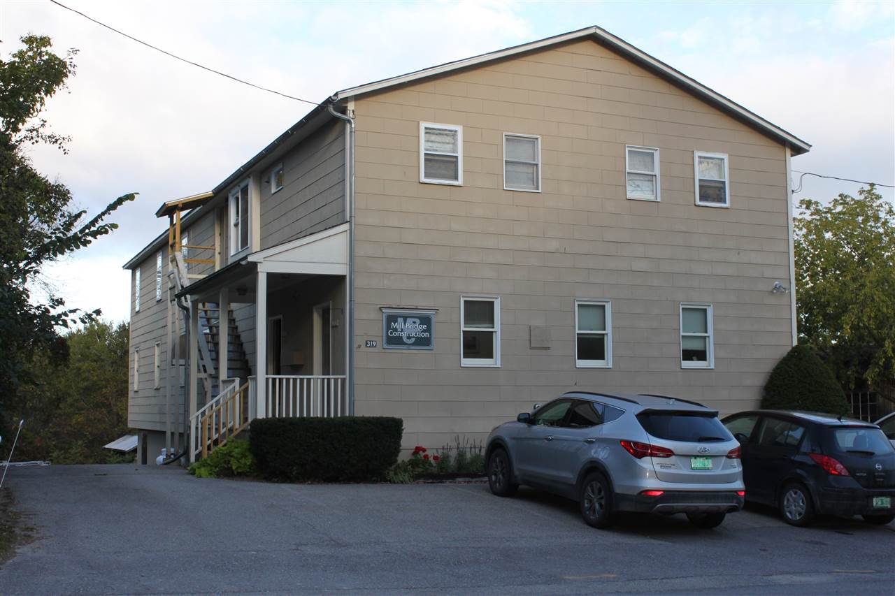 Great commercial building for sale! Located just over the Weybridge/Middlebury Town line. The Mill Bridge Construction building has over 4,500 square feet of office, storage, and light industrial/manufacturing space. The office space is well maintained and is comprised of 1,624 square feet located on the street side portion of the first and second floor. It includes a reception area, four/five offices, a conference room, a copy room, and two half baths. The shop space is approximately 2,000 square feet and includes a separate heating system, an 11' x 11' loading dock, and large overhead door. The storage space is approximately 1,256 square feet. The building also has dry basement storage accessible from a walk-in overhead door at the rear of the property. This property is also being marketed for lease.