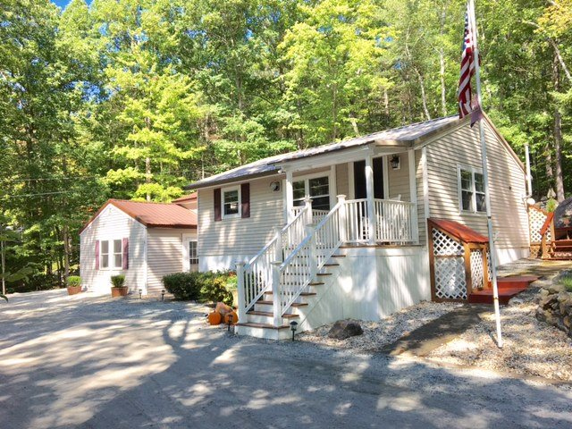 VILLAGE OF WEIRS BEACH IN TOWN OF LACONIA NH Homes for sale