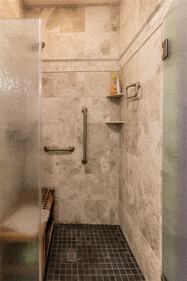 Custom, tiled shower in master bathroom 11165637