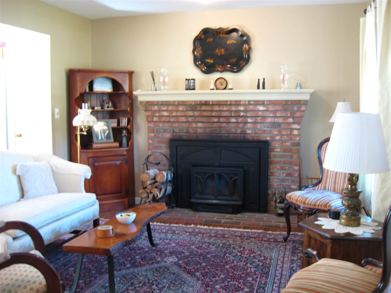 Wood stove insert in fireplace 11169308