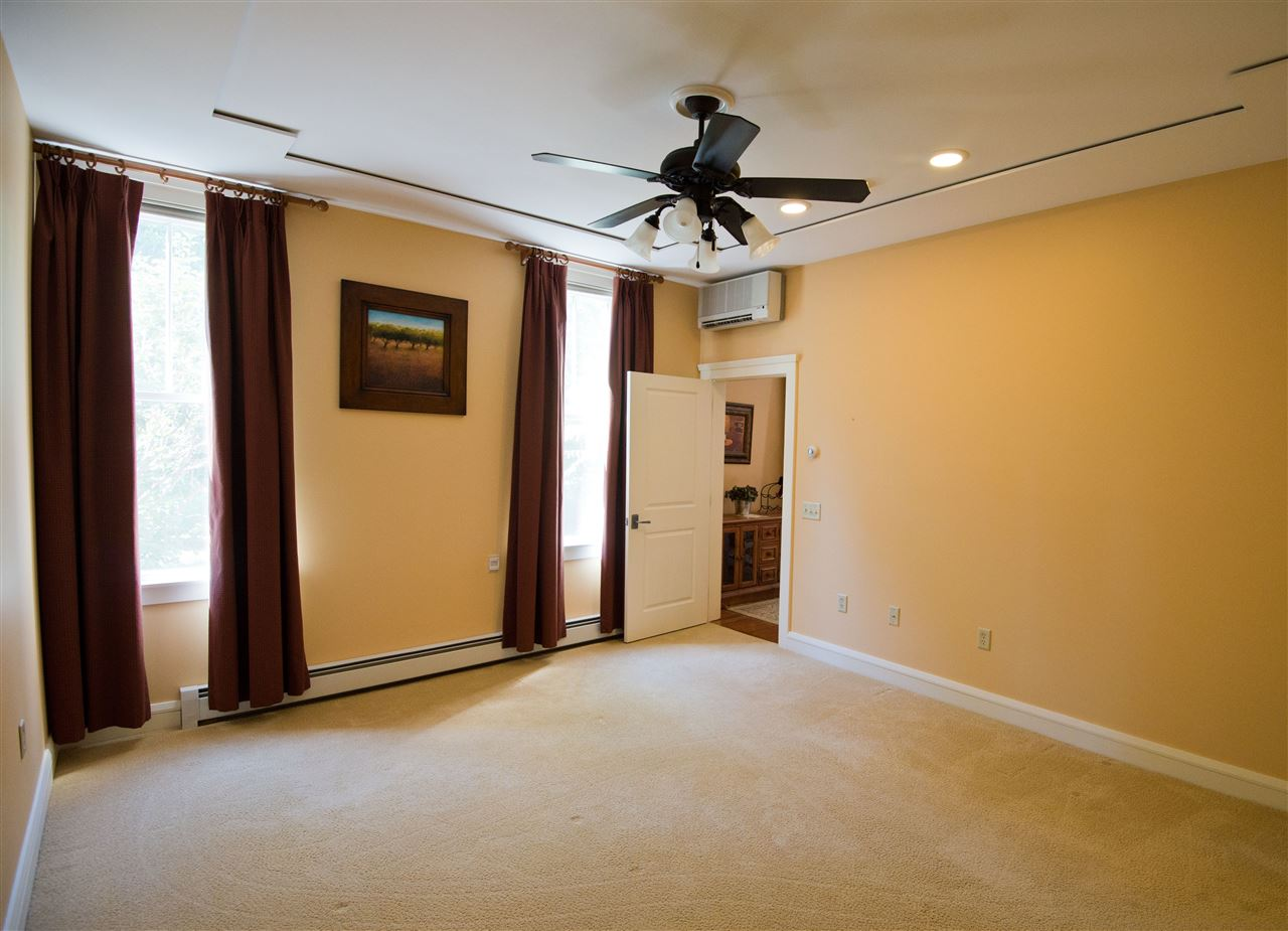 master bedroom with coffered ceiling 11182494