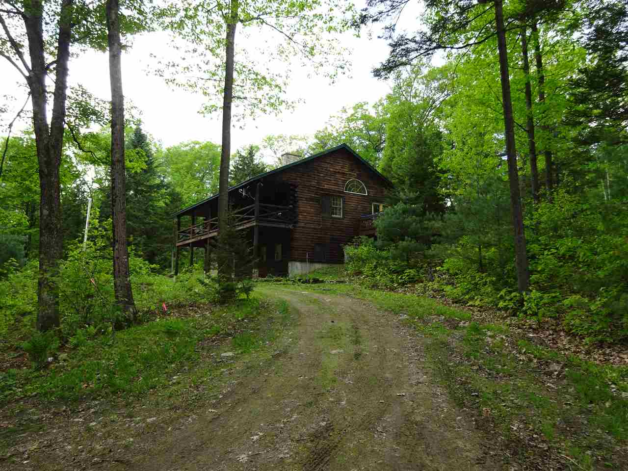 Very comfortable and well maintained 'like new' log home. 3 bedroom 2 bath. Lots of light. Fieldstone Fireplace in the living room.Hardwood floors throughout.Woodstove in the basement. Walkout basement has 9' ceilings & would finish nicely, or make a great shop or exercise area. 4 season recreation area. Miles of trails.Close to skiing. Nice.