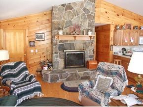Stone fireplace in living room 11389466
